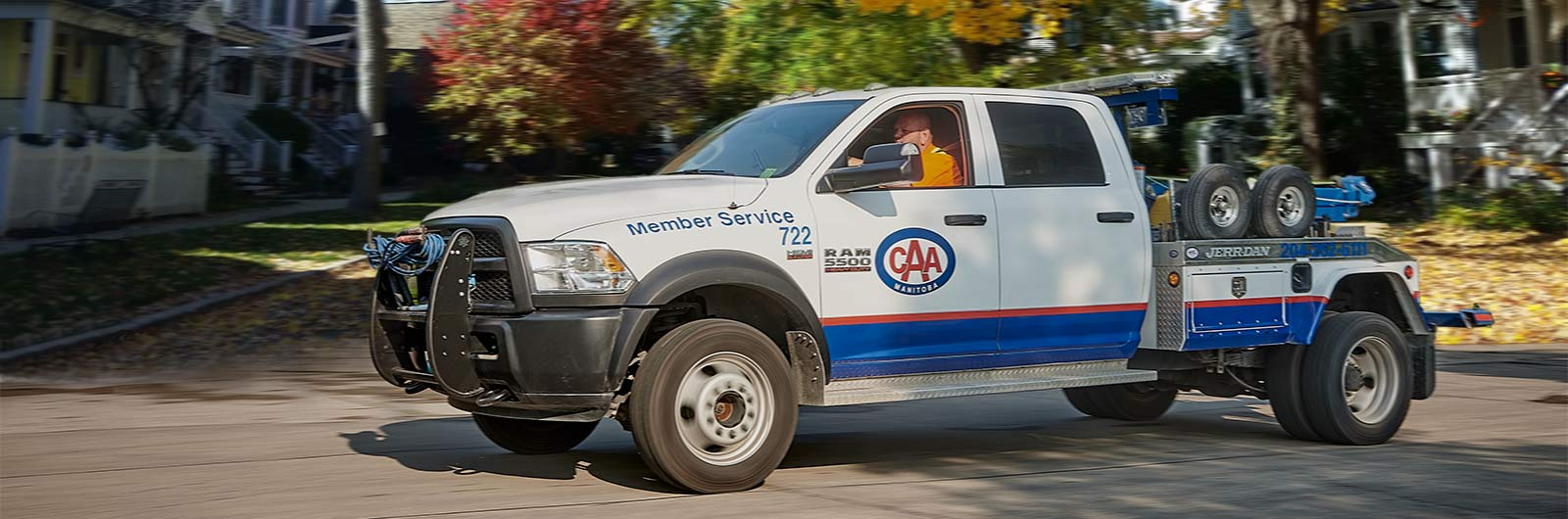 Image featuring CAA tow truck during autumn.