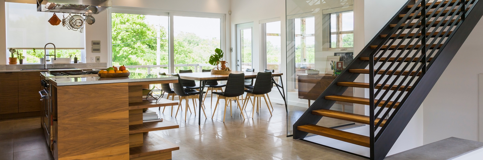 Couple standing on their veranda looking at each other.