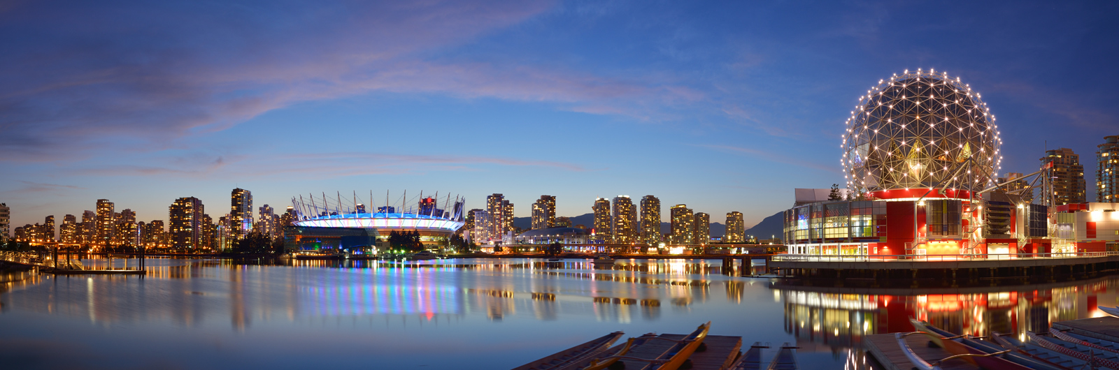 A picture of the Vancouver skyline at night featuring BC Place Stadium and Telus World of Science buildings featuring the words CAA Vacations exclusive benefits and get extras on your vacation just for being a CAA Member.