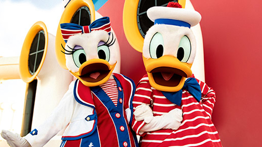 Image showing Donald and Dasiy Duck wearing nautical clothes and standing on deck.