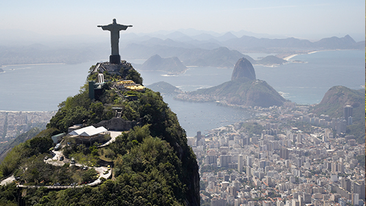 Christ the Redeemer statue atop a mountain.